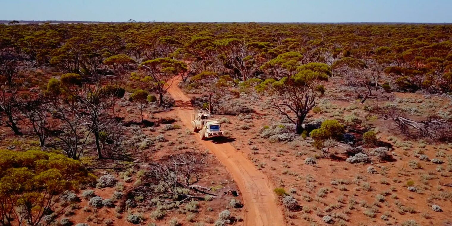 Mining truck driving through the Australian outback - play video